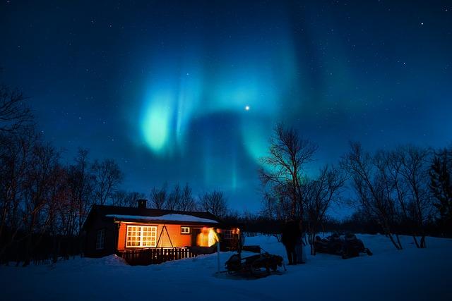 snowmobile trip aurora borealis